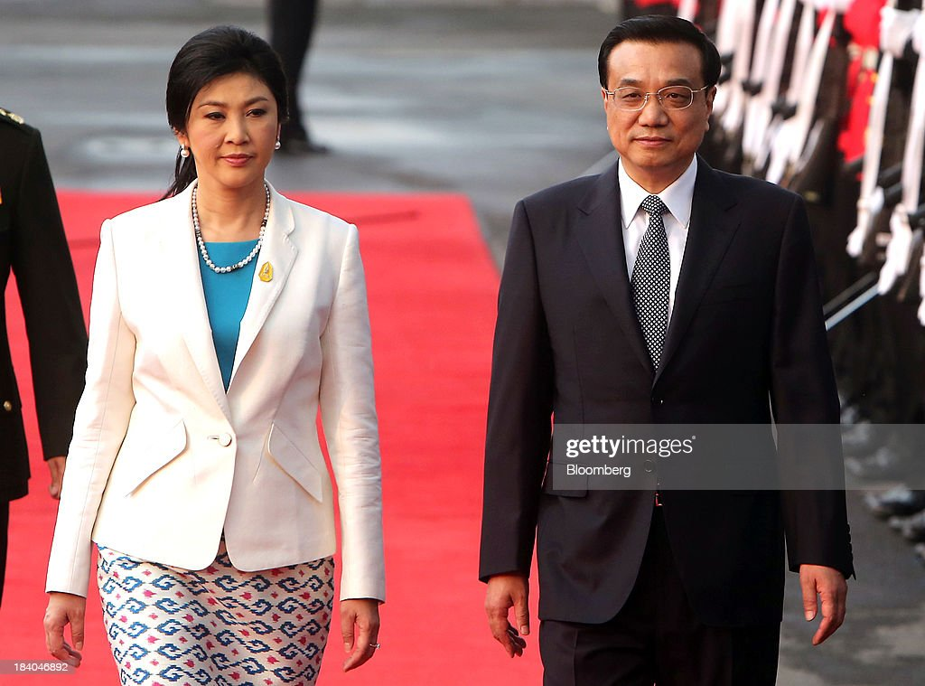 <a gi-track='captionPersonalityLinkClicked' href=/galleries/search?phrase=Li+Keqiang&family=editorial&specificpeople=2481781 ng-click='$event.stopPropagation()'>Li Keqiang</a>, China's premier, right, walks with <a gi-track='captionPersonalityLinkClicked' href=/galleries/search?phrase=Yingluck+Shinawatra&family=editorial&specificpeople=787330 ng-click='$event.stopPropagation()'>Yingluck Shinawatra</a>, Thailand's prime minister, past an honor guard during a welcoming ceremony in Bangkok, Thailand, on Friday, Oct. 11, 2013. Li said his country wants to resolve disputes in the South China Sea through dialogue and urged Southeast Asian nations to spur more trade and investment. Photographer: Dario Pignatelli/Bloomberg via Getty Images
