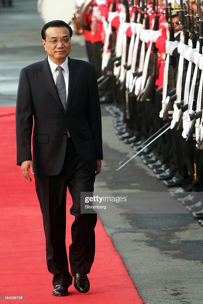 <a gi-track='captionPersonalityLinkClicked' href=/galleries/search?phrase=Li+Keqiang&family=editorial&specificpeople=2481781 ng-click='$event.stopPropagation()'>Li Keqiang</a>, China's premier, walks past an honor guard during a welcoming ceremony in Bangkok, Thailand, on Friday, Oct. 11, 2013. Li said his country wants to resolve disputes in the South China Sea through dialogue and urged Southeast Asian nations to spur more trade and investment. Photographer: Dario Pignatelli/Bloomberg via Getty Images