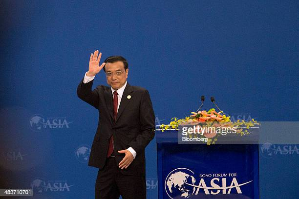 Li Keqiang China's premier waves after delivering a speech at the Boao Forum for Asia in Boao Hainan China on Thursday April 10 2014 Li said China...