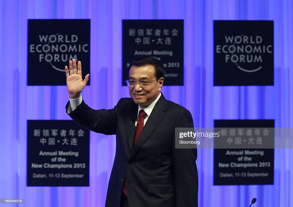 Li Keqiang, China's premier, waves as he arrives for the opening plenary at the World Economic Forum Annual Meeting of The New Champions in Dalian, China, on Wednesday, Sept. 11, 2013. Li said the foundations of a growth rebound aren't solid while cautioning that stimulus won't help resolve deep-rooted issues in the world's second-largest economy. Photographer: Tomohiro Ohsumi/Bloomberg via Getty Images