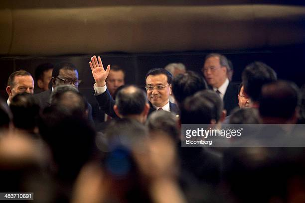 Li Keqiang China's premier waves to attendees at the Boao Forum for Asia in Boao Hainan China on Thursday April 10 2014 Li said China plans to...