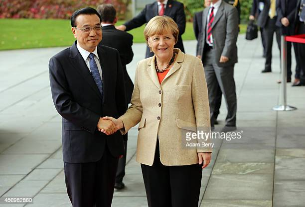 Li Keqiang premier of the People's Republic of China and party secretary of the State Council arrives during a military ceremony with German...