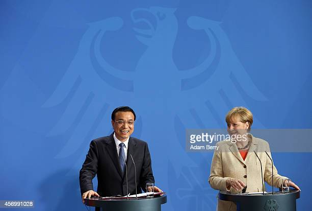 Li Keqiang premier of the People's Republic of China and party secretary of the State Council speaks at a news conference with German Chancellor...