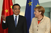 Li Keqiang premier of the People's Republic of China and party secretary of the State Council and German Chancellor Angela Merkel arrive for a...