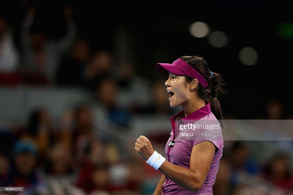 Li Na of China celebrates winning against Sabine Lisicki of Germany during her women's singles match on day five of the 2013 China Open at the National Tennis Center on October 2, 2013 in Beijing, China.