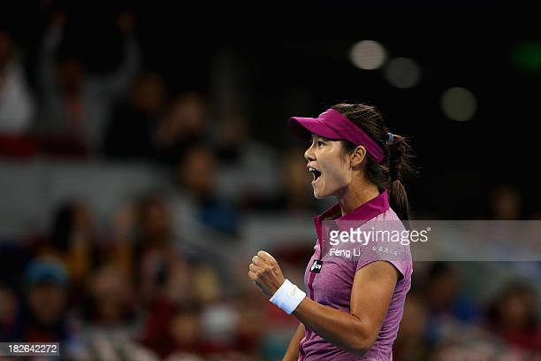 Li Na of China celebrates winning against Sabine Lisicki of Germany during her women's singles match on day five of the 2013 China Open at the...