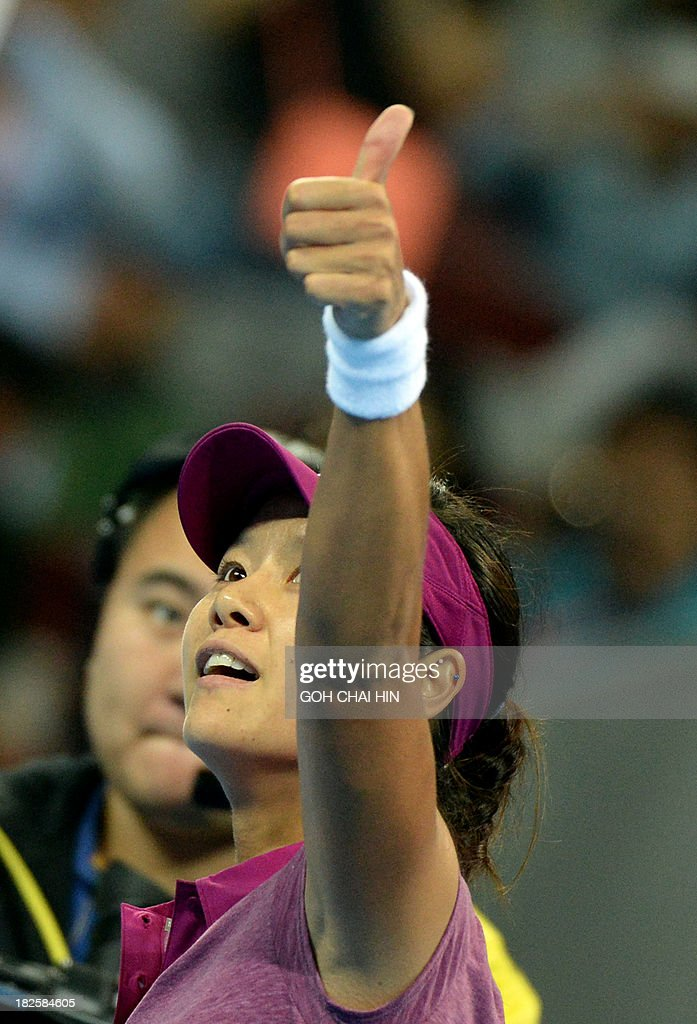 Li Na of China gives the thumbs up to her fans after beating Bojana Jovanovski of Serbia in their women's singles match at the China Open tennis tournament in the National Tennis Center of Beijing on October 1, 2013. Li won 6-0, 6-1.