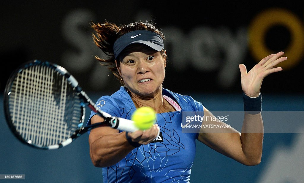 Li Na of China hits a return against Madison Keys of the US during their quarter-final match at the Sydney International tennis tournament on January 9, 2013. AFP PHOTO / MANAN VATSYAYANA USE