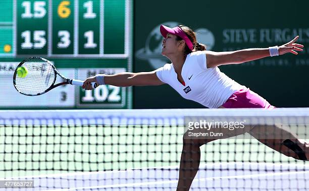 Li Na of China hits a return to Karolina Pliskova of the Czech Republic during the BNP Paribas Open at Indian Wells Tennis Garden on March 9 2014 in...