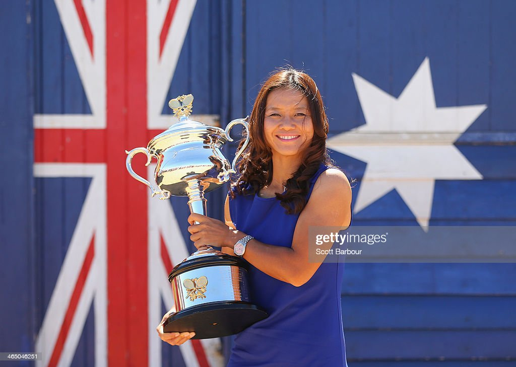 Li Na of China holds the Daphne Akhurst Memorial Cup during a photocall at Brighton Beach after winning the 2014 Australian Open on January 26, 2014 in Melbourne, Australia.