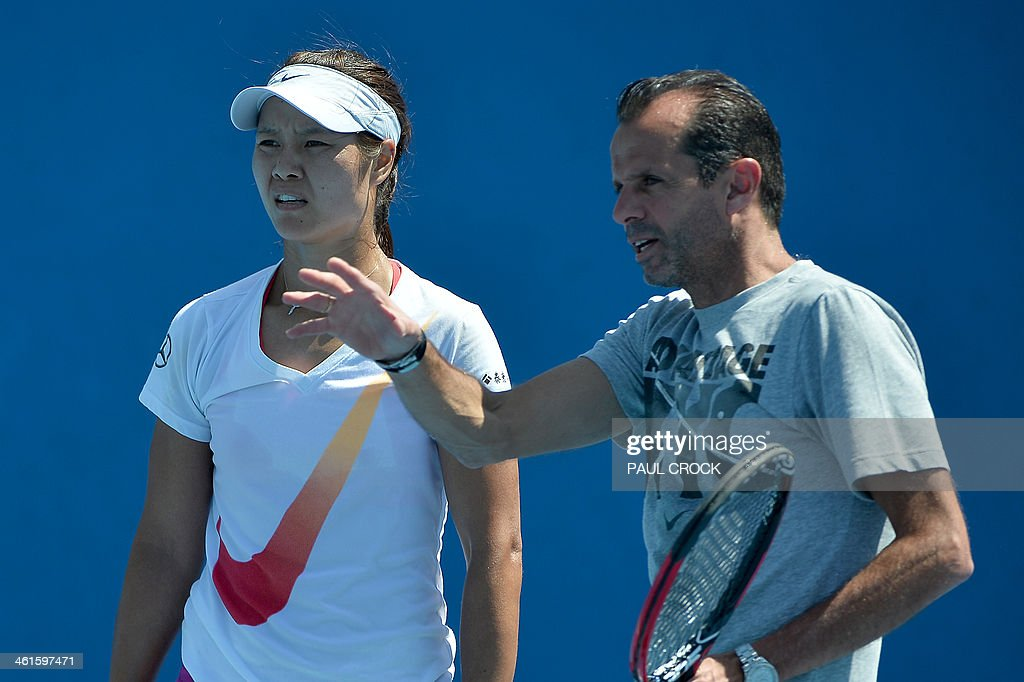 Li Na of China listens to coach Carlos Rodriguez during a practice session ahead of the Australian Open tennis tournament in Melbourne on January 10...