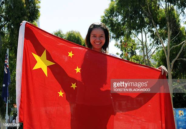 Li Na of China poses with a flag on the twelfth day of the Australian Open tennis tournament in Melbourne on January 28 2011 China's tennis chief has...