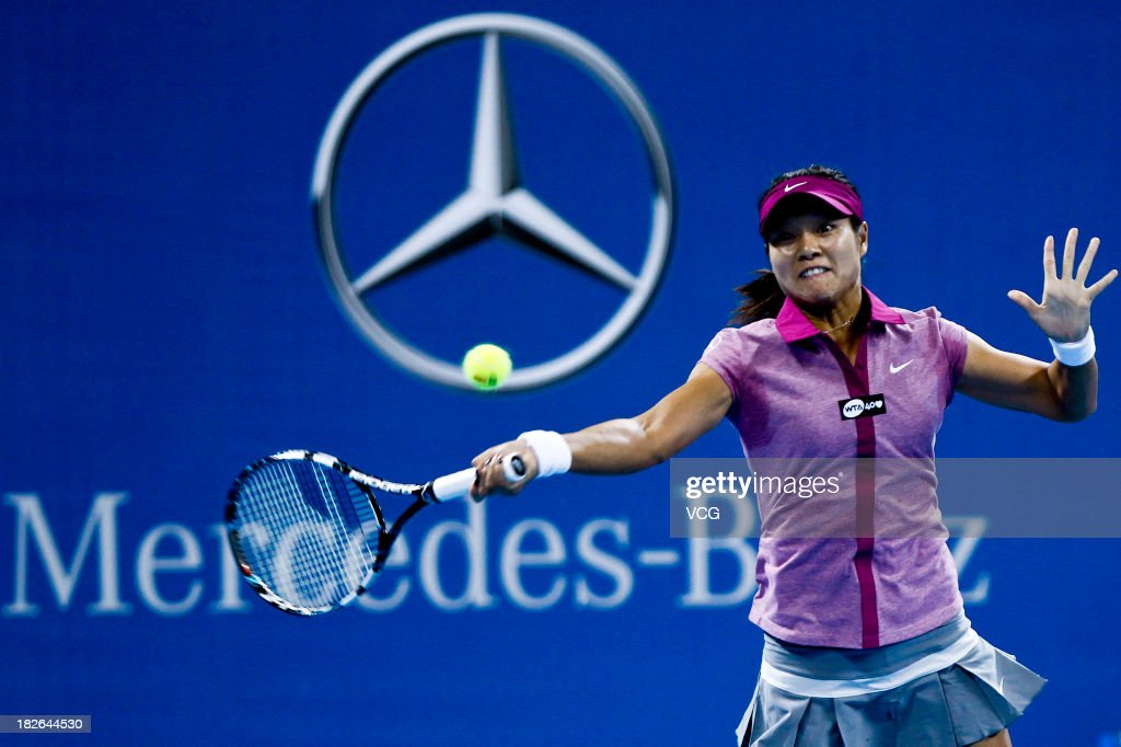 Li Na of China returns a ball to Sabine Lisicki of Germany on day five of the 2013 China Open at National Tennis Center on October 2, 2013 in Beijing, China.