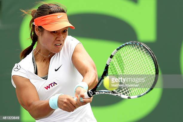 Li Na of China returns a sbot to Serena Williams during the final of the Sony Open at the Crandon Park Tennis Center on March 29 2014 in Key Biscayne...