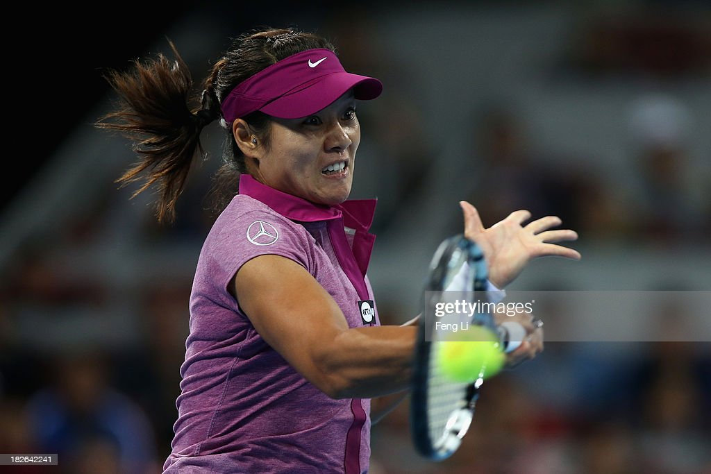 Li Na of China returns a shot during her women's singles match against Sabine Lisicki of Germany on day five of the 2013 China Open at the National Tennis Center on October 2, 2013 in Beijing, China.