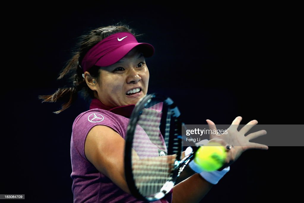 Li Na of China returns a shot during her women's singles match against Petra Kvitova of Czech Republic on day seven of the 2013 China Open at the National Tennis Center on October 4, 2013 in Beijing, China.