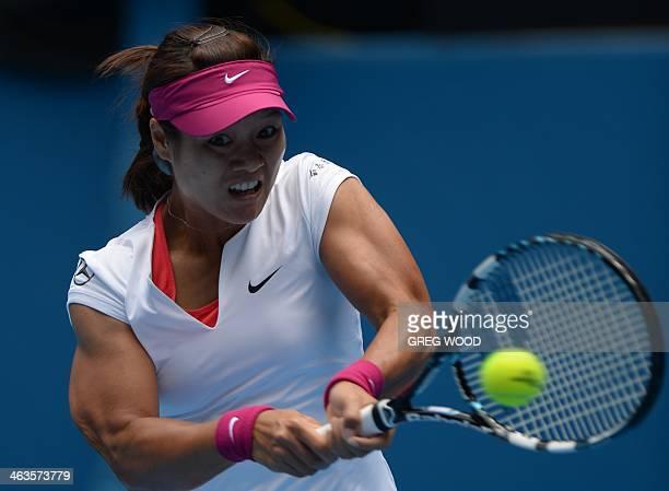 Li Na of China returns to Ekaterina Makarova of Russia during their women's singles match on day seven of the 2014 Australian Open tennis tournament...
