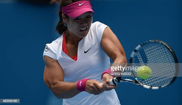 Li Na of China returns to Katerina Makarova of Russia during their women's singles match on day seven of the 2014 Australian Open tennis tournament...