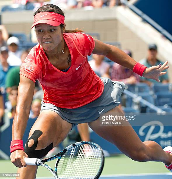 Li Na of China rushes the net for a return to Laura Robson of Great Britain during their US Open 2013 women's singles match at the USTA Billie Jean...
