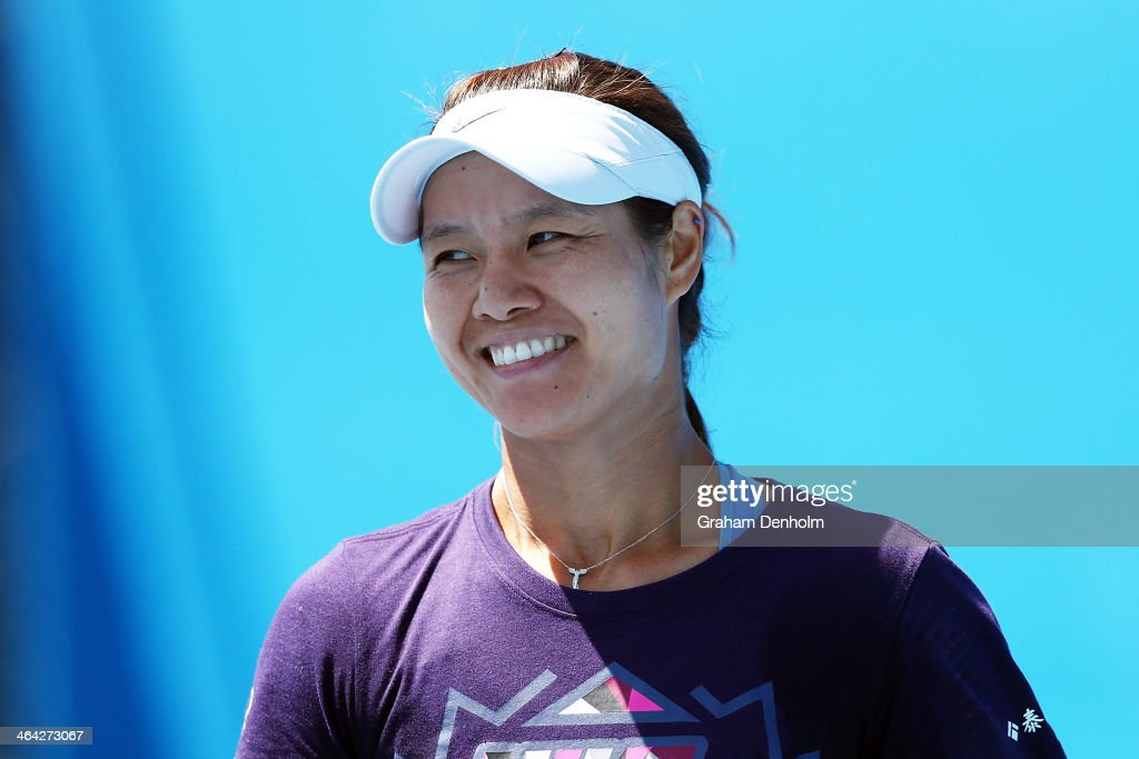 Li Na of China smiles during a practice session during day 10 of the 2014 Australian Open at Melbourne Park on January 22, 2014 in Melbourne, Australia.