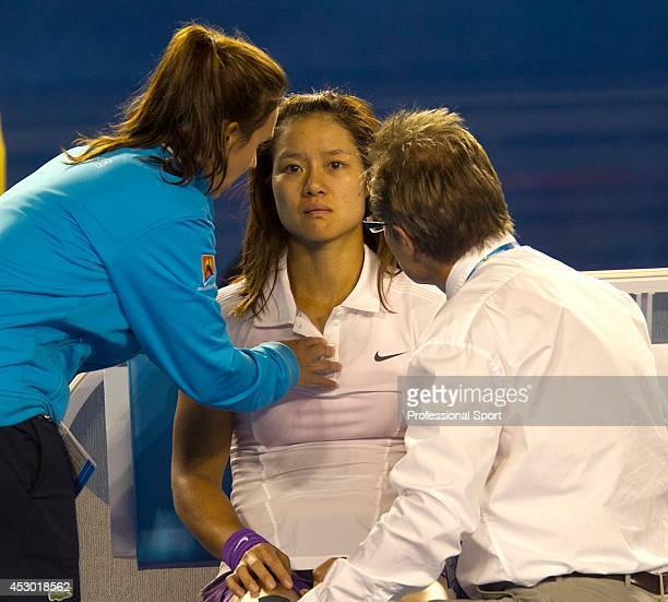 Li Na of China taking a medical time out for an injury sustained in her women's final match against Victoria Azarenka of Belarus during day thirteen...