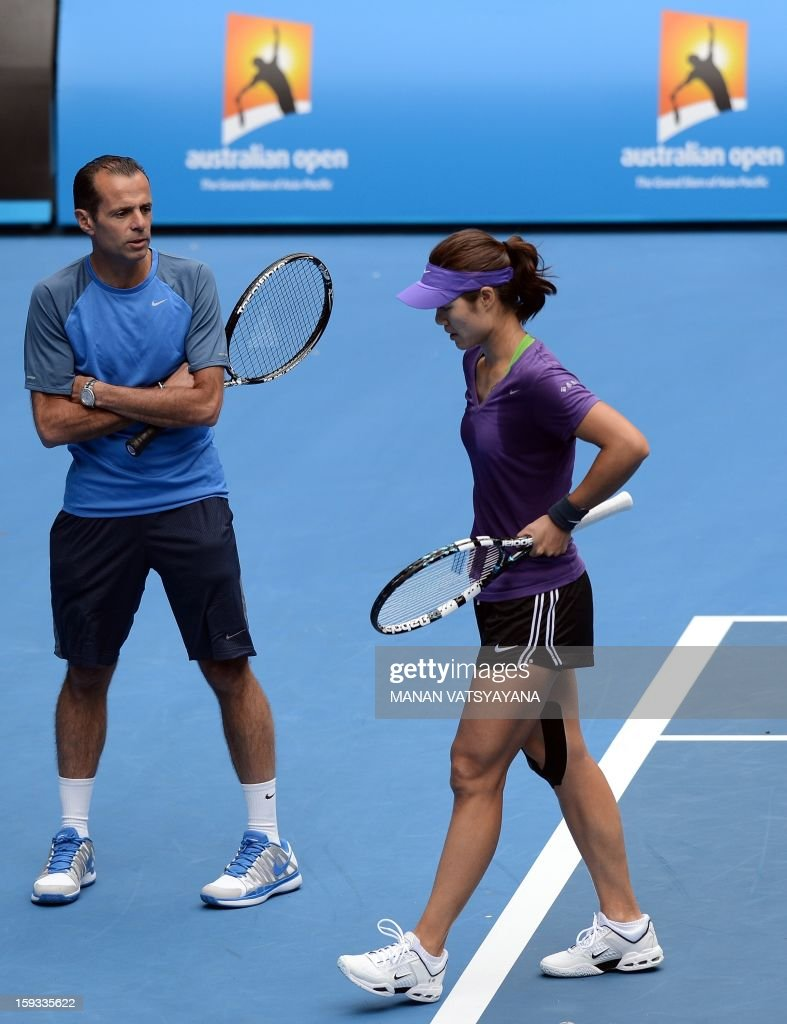 Li Na of China talks with her coach Carlos Rodriguez during a practice session for the upcoming Australian Open tennis tournament in Melbourne on...