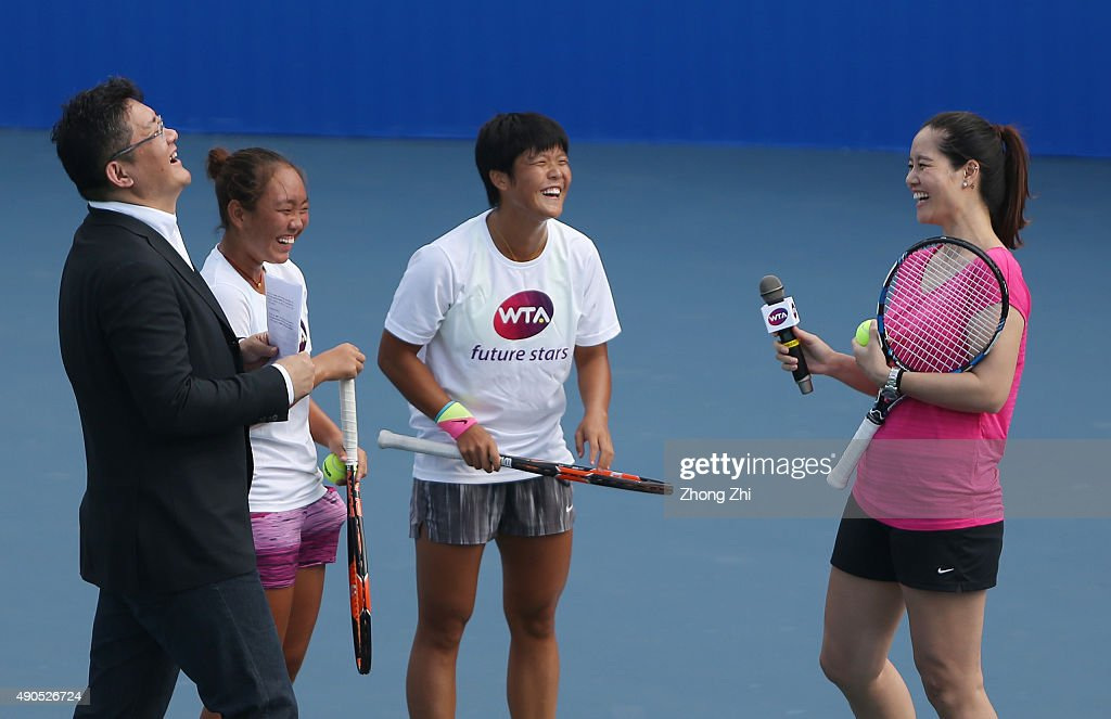 Li Na of China with two Chinese teenager tennis players Guo Meiqi and Chu Jiayu during the WTA Future Star Li Na Masterclass event on Day 3 of 2015...