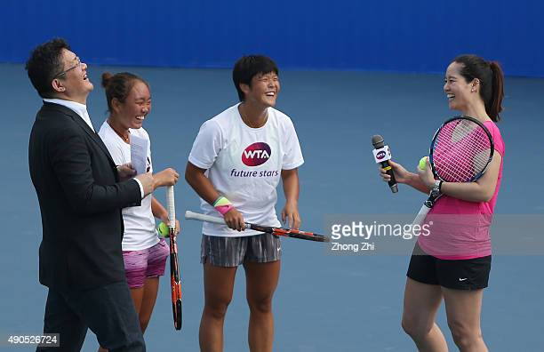 Li Na of China with two Chinese teenager tennis players Guo Meiqi and Chu Jiayu during the WTA Future Star Li Na Masterclass event on Day 3 of 2015...