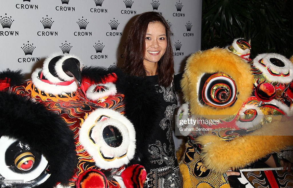 Li Na poses with chinese dragons as she arrives at Crown's IMG Tennis Player's Party at Crown Towers on January 13, 2013 in Melbourne, Australia.