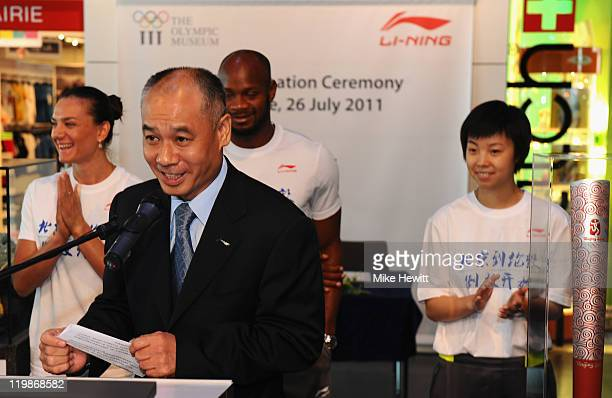 Li Ning Chairman of Li Ning makes a speech as Yelena Isinbayeva of Russia Asafa Powell of Jamaica and Zhang Yining of China look on during the Li...
