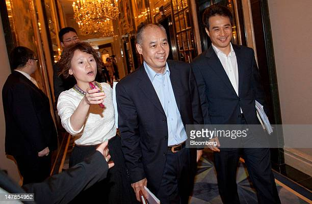 Li Ning founder and chairman of Li Ning Co second right and Kim JinGoon vice chairman right arrive at a news conference in Hong Kong China on...