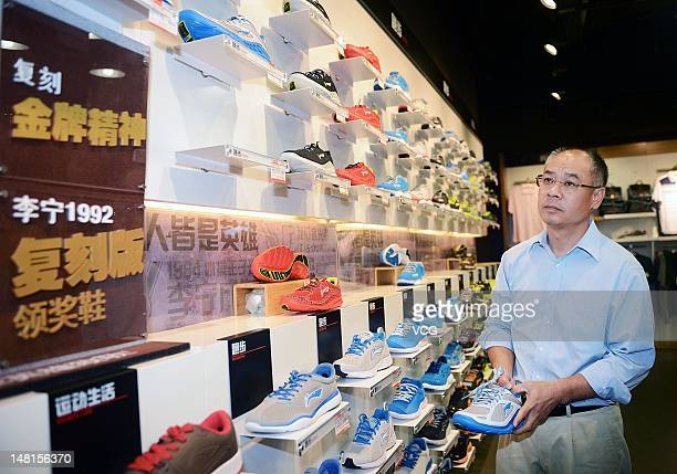 Li Ning founder and chairman of Li Ning Co visits a Li Ning flagship store on July 10 2012 in Chengdu China Li Ning Co Ltd saw its chief executive...