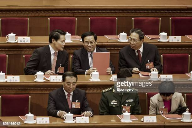 Li Qiang China's Communist Party Secretary of Jiangsu Province back row center attends the closing ceremony of the National People's Congress in...