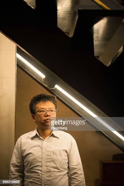 Li Qiang executive director of China Labor Watch stands for a photograph at the organization's headquarters in New York US on Wednesday June 14 2017...