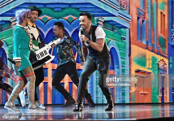 Li Saumet and Simon Mejia of Bomba Estereo and Luis Fonsi perform onstage during The 18th Annual Latin Grammy Awards at MGM Grand Garden Arena on...