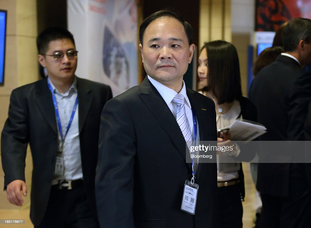 Li Shufu, chairman of Geely Automobile Holdings Ltd., arrives at the Global Automotive Forum in Wuhan, China, on Friday, Oct. 18, 2013. The forum concludes today. Photographer: Tomohiro Ohsumi/Bloomberg via Getty Images