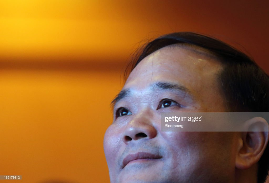 Li Shufu, chairman of Geely Automobile Holdings Ltd., attends a session at the Global Automotive Forum in Wuhan, China, on Friday, Oct. 18, 2013. The forum concludes today. Photographer: Tomohiro Ohsumi/Bloomberg via Getty Images