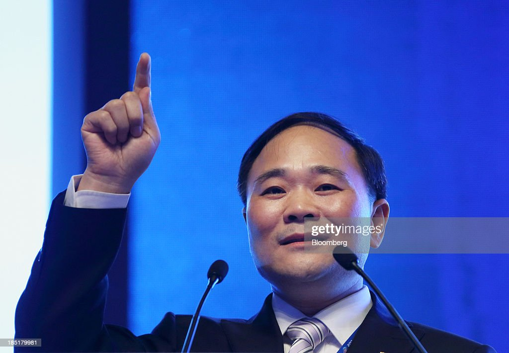 Li Shufu, chairman of Geely Automobile Holdings Ltd., gestures as he speaks during a session at the Global Automotive Forum in Wuhan, China, on Friday, Oct. 18, 2013. The forum concludes today. Photographer: Tomohiro Ohsumi/Bloomberg via Getty Images