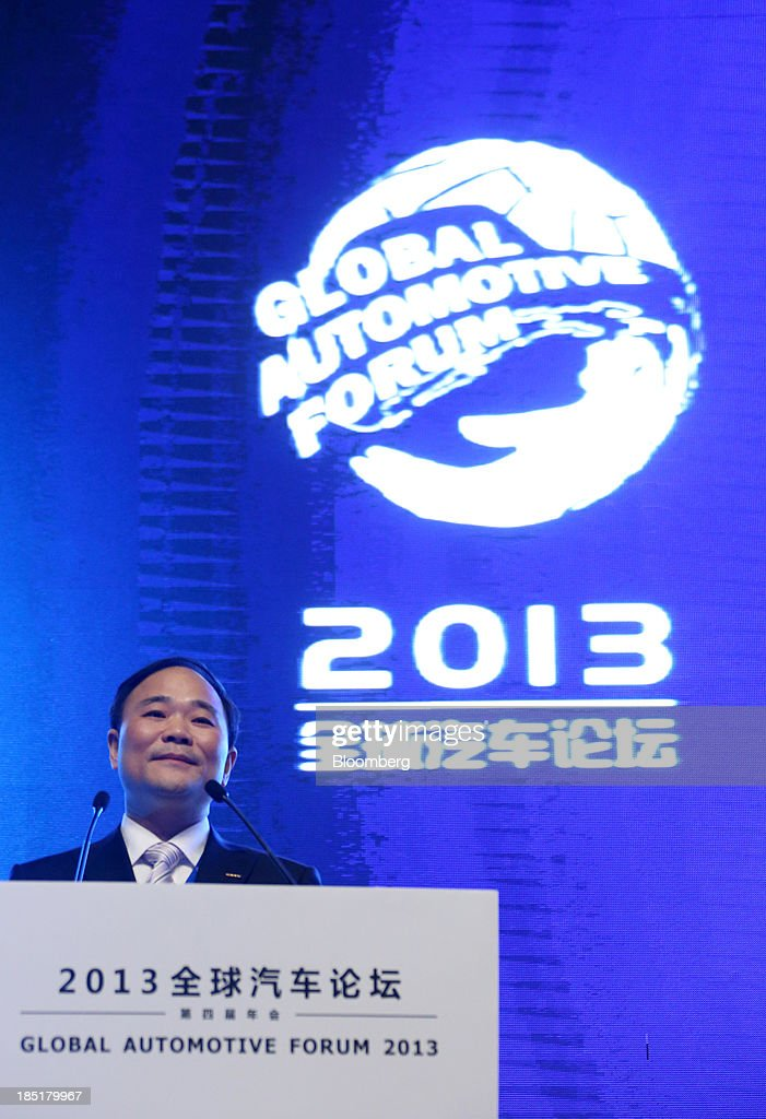 Li Shufu, chairman of Geely Automobile Holdings Ltd., speaks during a session at the Global Automotive Forum in Wuhan, China, on Friday, Oct. 18, 2013. The forum concludes today. Photographer: Tomohiro Ohsumi/Bloomberg via Getty Images