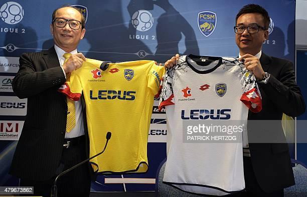 Li WingSang CEO of HongKong based lighting company Ledus and financial director Chi Hung Chiu show the new jerseys of Sochaux's football club on July...