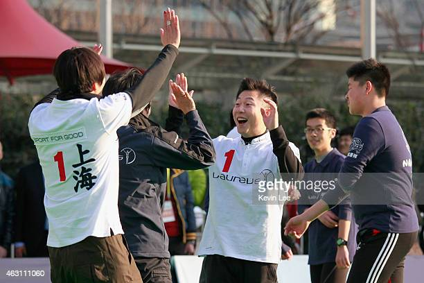 Li Xiao Ping reacts after their team win a goal at a football match at a football clinic at Oriental Pearl Tower in Shanghai on February 10 2015 in...