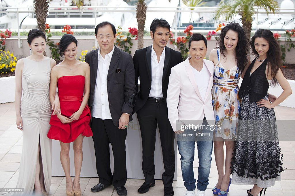 Li Xiao Ran, Kara Hui, Jimmy Wang Yu, Takeshi Kaneshiro, Donnie Yen, Cecilia Cissy Wang, and Tang Wei attend the 'Wu Xia' Photocall at the Palais des Festivals during the 64th Cannes Film Festival on May 14, 2011 in Cannes, France.