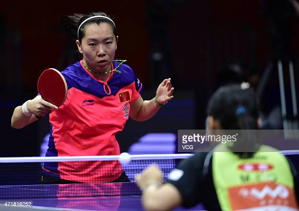 Li Xiaoxia of China competes against Mima Ito of Japan during women's singles quarterfinal match on day six of the 2015 World Table Tennis...