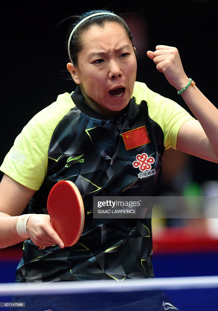 Li Xiaoxia of China reacts to winning a point during the women's singles final match against Ishikawa Kasumi of Japan at the Asian Table Tennis Qualification Tournament for the 2016 Rio Olympic Games at the Queen Elizabeth Stadium in Hong Kong on April 14, 2016. / AFP / ISAAC