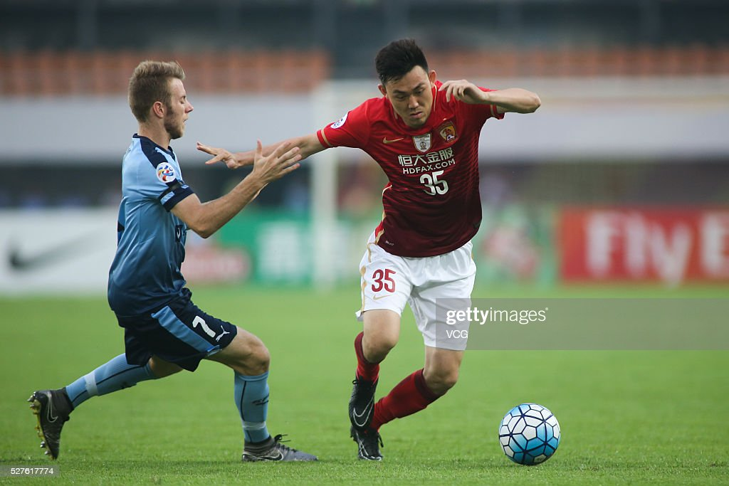 Li Xuepeng #35 of Guangzhou Evergrande and Andrew Hoole #7 of Sydney FC compete for the ball during the AFC Asian Champions League match between Guangzhou Evergrande FC and Sydney FC at Tianhe Stadium on May 3, 2016 in Guangzhou, China.