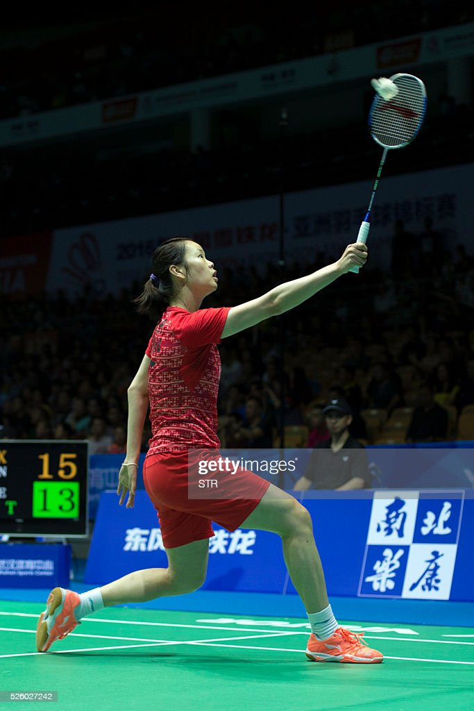 Li Xuerui of China hits a return against Tai Tzu Ying of Taipei during their women's singles quarter-final match at the 2016 Badminton Asia Championships in Wuhan, central China's Hubei province on April 29, 2016. / AFP / STR