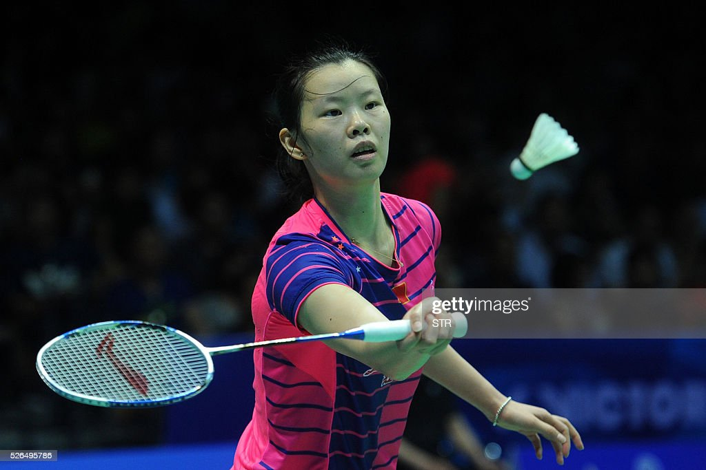 Li Xuerui of China plays a return to Sung Ji Hyun of South Korea during their women's singles semi-final match at the 2016 Badminton Asia Championships in Wuhan, central China's Hubei province on April 30, 2016. / AFP / STR