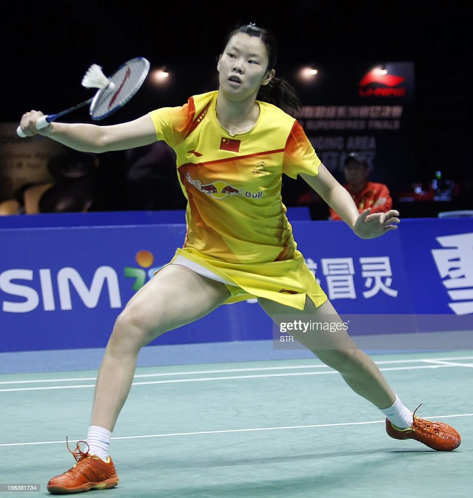 Li Xuerui of China returns a shot against Saina Nehwal of India in the women's singles event of the 2012 BWF Superseries Finals in Shenzhen, south China's Guangdong province on December 15, 2012. Li beat Nehwal 22-20, 7-21, 21-13 to move into the final. AFP PHOTO