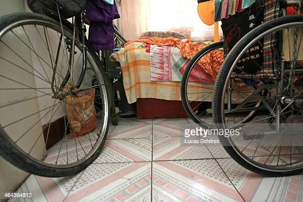Li Yan's wheelchair's wheels next to her father's bicycle's in her home on May 7 2007 in Yinchuan Ningxia Province China 28yearold Li Yan suffers...