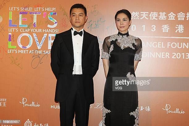Li Yapeng and Faye Wong attend the Yanran Angel Foundation 2013 at the Inter Continental Hong Kong on May 27 2013 in Hong Kong China
